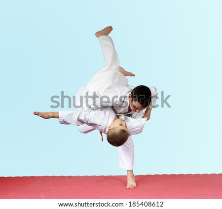 Throws judo two athletes are training on the mat #185408612