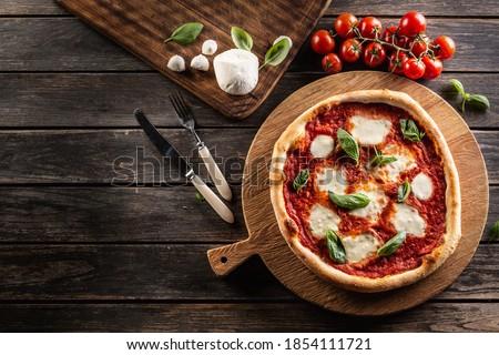 Pizza Napoletana - Napoli tomato sauce mozzarella and basil - top of view. Royalty-Free Stock Photo #1854111721