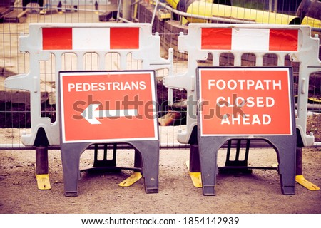 Footpath closed sign for pedestrian safety from road construction Royalty-Free Stock Photo #1854142939