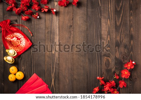 "The Chinese new year festival, Top view flat lay happy Chinese new year or lunar new year decorations celebration with copy space on wood background (Chinese character ""FU"" meaning fortune good luck)"