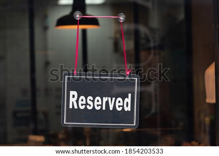 Reserved sign, reservation concept. Table tent, reserved text on a wooden table, banner, copy space. #1854203533