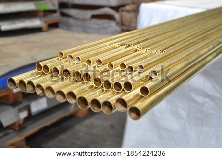 brass yellow brass pipe copper pipe factory  Royalty-Free Stock Photo #1854224236