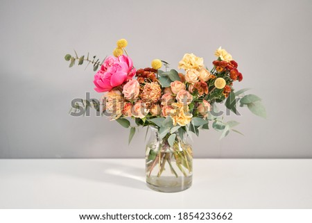 Bouquet 011. Finished flower arrangement in a vase for home. Flowers bunch, set for interior. Fresh cut flowers for decoration home. European floral shop. Delivery fresh cut flower. Royalty-Free Stock Photo #1854233662