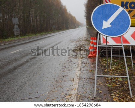 detour sign on the right. temporary road signs on the road. repair of roads