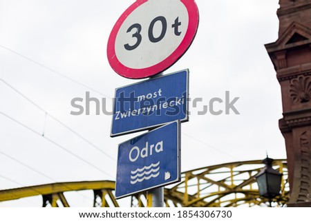 Weight limit 30 tons road sign on Odra river in Poland, Wroclaw. Most Zwierzyniecki - Translation - Zoo bridge. Odra - Translation - Odra river  Royalty-Free Stock Photo #1854306730