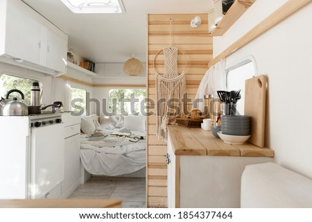 Camping in trailer, rv kitchen and bedroom, nobody Royalty-Free Stock Photo #1854377464