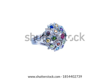 Platinum ring with nine color gem stone decoration on top isolated on white background. Silver or white gold ring decorative with colorful gemstone design #1854402739