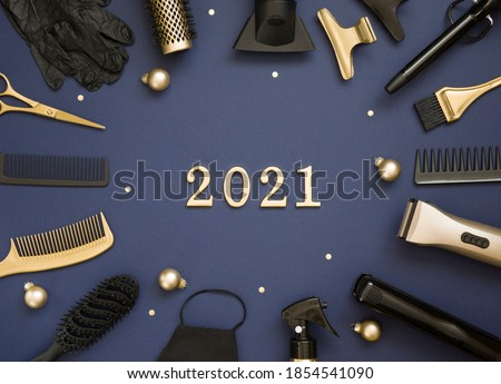 New year's banner with hairdressing tools, Christmas balls and numbers 2021. Gold and black hair salon accessories on a blue background. #1854541090