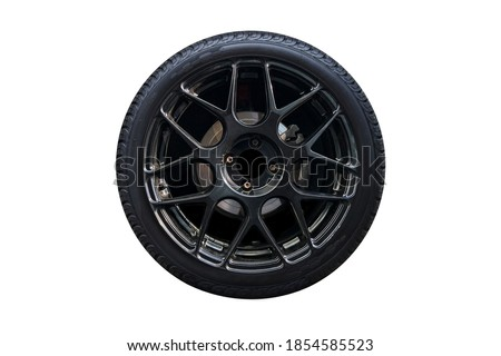 Clipping path. Black Wheel super car isolated on white background view. Magneto wheels. Movement. Wheel super car. #1854585523