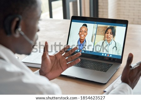 Multicultural doctors team conferencing in video call chat discussing health care learning online during web seminar. Group medical webinar training, healthcare elearning videoconference concept. Royalty-Free Stock Photo #1854623527