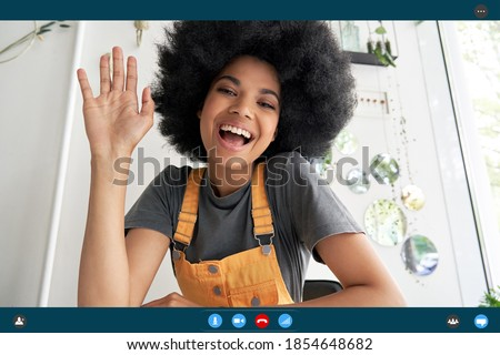 Happy young african woman waving hand saying hi looking at webcam talking to camera making video conference call virtual meeting distance friend, headshot portrait. Videocall screenshot. Web cam view #1854648682