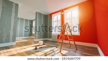 Painting wall red in room before and after restoration or refurbishment Royalty-Free Stock Photo #1854684709