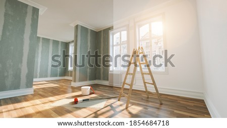 renovation concept - apartment before and after restoration or refurbishment with paint bucket and Flattened drywall walls Royalty-Free Stock Photo #1854684718