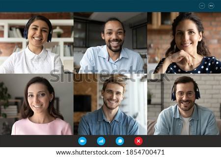 Computer screen web camera view happy multiracial millennial friends or colleagues communicating distantly, chatting in group conference video call from home or enjoying online training seminar. Royalty-Free Stock Photo #1854700471