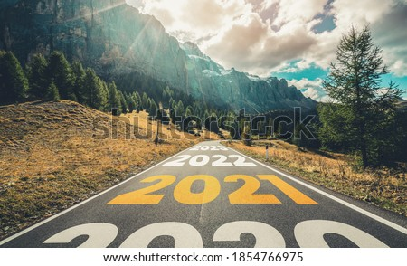 2021 New Year road trip travel and future vision concept . Nature landscape with highway road leading forward to happy new year celebration in the beginning of 2021 for fresh and successful start . #1854766975