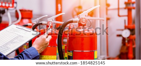 Engineer checking Industrial fire control system,Fire Alarm controller, Fire notifier, Anti fire.System ready In the event of a fire. #1854825145