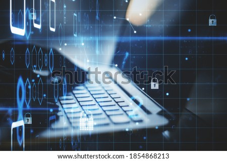 Hand using laptop with digital padlock interface and  binary code. Protection and web safety concept