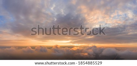 Panorama of Dramatic vibrant color with beautiful cloud of sunrise and sunset. Panoramic image Royalty-Free Stock Photo #1854885529