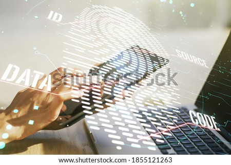 Double exposure of abstract creative fingerprint hologram with finger clicks on a digital tablet on background, protection of personal information concept #1855121263