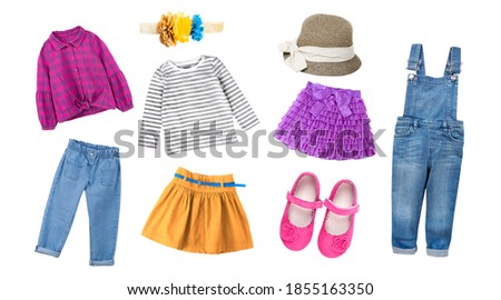Fashion  colorful child girl's clothing,bright collection of kid's apparel,baby garment set,collage of clothes isolated on white. Royalty-Free Stock Photo #1855163350