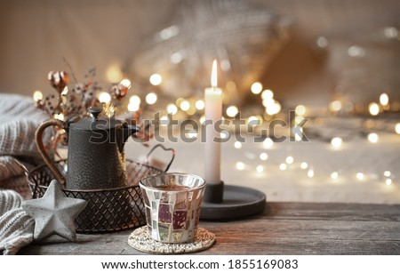 Composition with home decor details on a wooden table. The concept of a cozy home atmosphere. Royalty-Free Stock Photo #1855169083