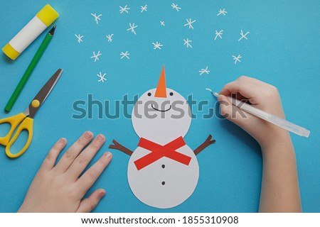 Crafts for children. little Child making winter decoration from paper. Children's art project. DIY concept. Handmade Easy Paper Crafts For Kids Royalty-Free Stock Photo #1855310908
