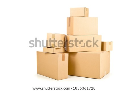 Stack or heap of brown carton cardboard boxes over white background, freight, deilvery or shipping concept