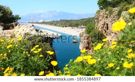 Blue lagoon and Konyaalti beach in  popular resort city Antalya. Konyaalti beach and the Mediterranean sea, Taurus Mountains in the background. Aerial view of beautiful blue gulf  Royalty-Free Stock Photo #1855384897