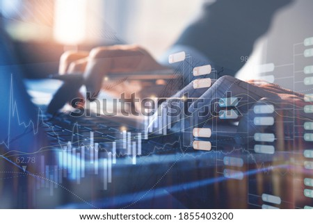 Business intelligence, blockchain technology, big data concept. Business man working on laptop computer with financial graph, monitoring on stock market report and encrypted blocks on virtual screen Royalty-Free Stock Photo #1855403200