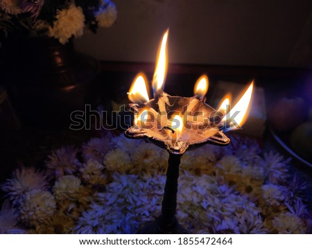 utttarakhand,india-3 may 2020:oil lamp in temple.this is a picture of traditional oil lamp in temple.flames in dark.flames on oil lamp.oil lamp in temple.