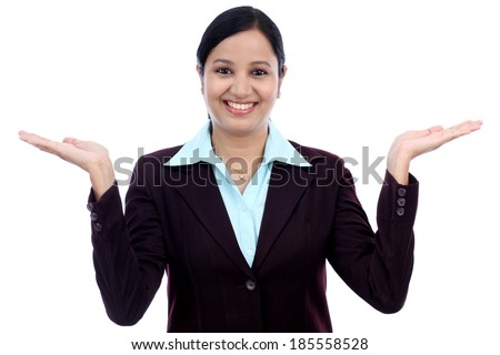 Excited young business woman against white background #185558528