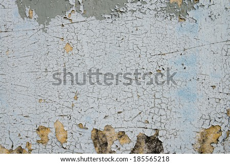old cracked paint on the concrete wall  #185565218