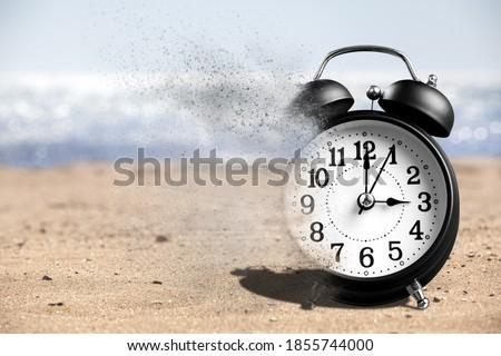 Dissolving old retro alarm clock. Dissolving time