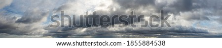 Fantastic dark blue thunderclouds at sunrise, natural composition Royalty-Free Stock Photo #1855884538