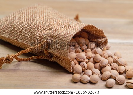 Cherry kernels in a jute bag, close-up Royalty-Free Stock Photo #1855932673