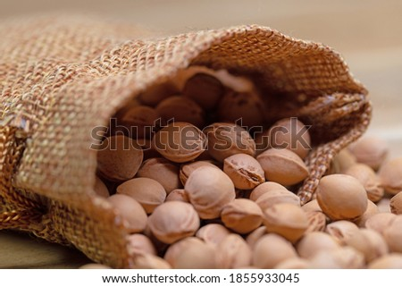 Cherry kernels in a jute bag, close-up Royalty-Free Stock Photo #1855933045
