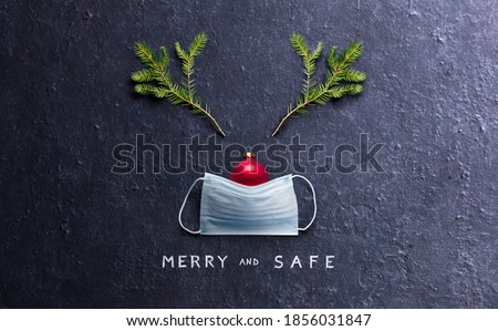 Minimal Christmas Concept - Merry And Safe - Reindeer Made With Face mask And Decorations Royalty-Free Stock Photo #1856031847