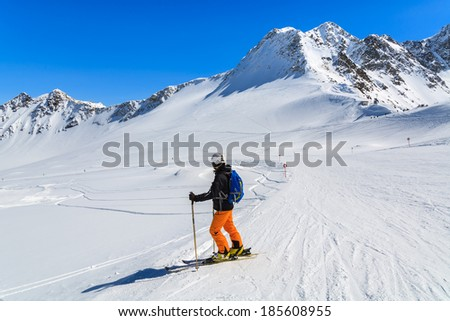 PITZTAL GLACIER, AUSTRIA - MAR 29: Woman skier on slope in the mountains of Pitztal winter resort on 29th March 2014, Austrian Alps  #185608955