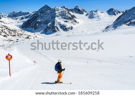 PITZTAL GLACIER, AUSTRIA - MAR 29: Woman skier on slope in the mountains of Pitztal winter resort on 29th March 2014, Austrian Alps  #185609258