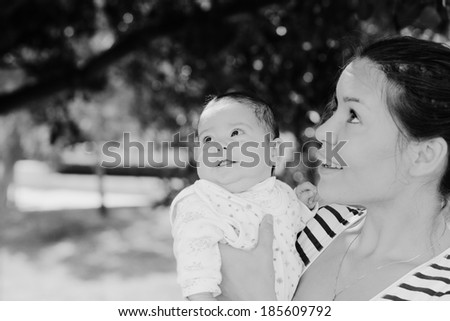 Portrait of happy loving mother and her baby outdoors #185609792