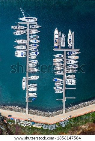 The drone aerial view of sailing yachts moored in marina on coast of the Portuguese island of Madeira Royalty-Free Stock Photo #1856147584