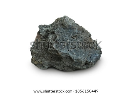 basalt rock stone isolated on a white background. Basalt is a mafic extrusive igneous rock. Royalty-Free Stock Photo #1856150449