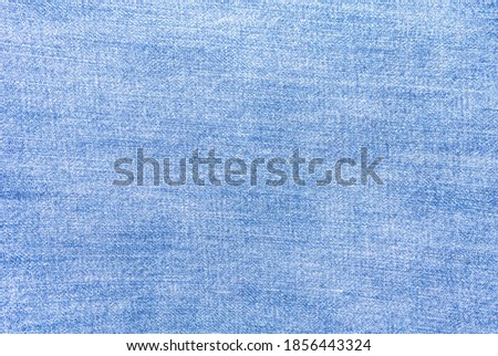 Perspective and closeup view to abstract space of empty natural clean denim texture for the traditional business background in cold bright colors with diagonal shift tilt lines and stitches