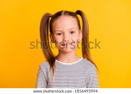 Portrait of nice cute adorable sweet cheerful blond girl isolated on bright shine yellow color background