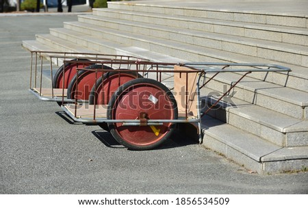 Two handcart on the staircase. Royalty-Free Stock Photo #1856534509