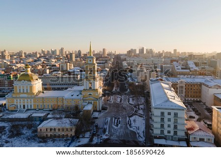 Aerial drone view of Perm city, art gallery and long street in the city centre in sunny winter day with snow on the roofs Royalty-Free Stock Photo #1856590426
