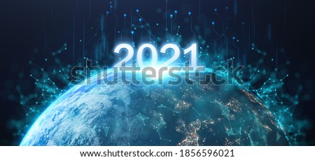 2021 futuristic technology concept, happy new year in earth on planet background with connection of comunitity technology , high growth of tech around world  Elements of this image furnished by NASA #1856596021