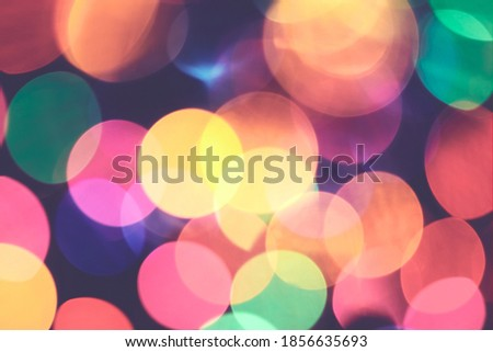 Abstract bokeh background made of defocused of Christmas lights, retro color toned picture.