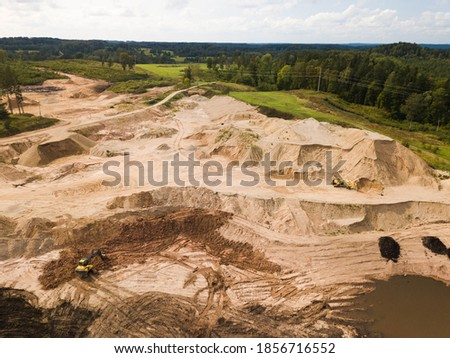 Aerial photo. Excavators at construction site. Earthmoving at open pit mining. Digging ground.