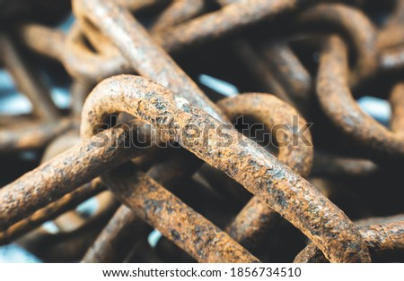 Rusty chains on white background. Close up photo. Royalty-Free Stock Photo #1856734510